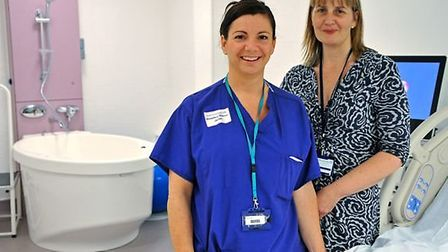 Maternity staff pose beside one of the new birthing pools in Homerton Hospital's maternity wing