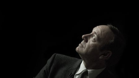 Kevin Spacey lost in thought as he watches a montage of his work at the JW3 event. Picture: � Blake