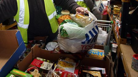 Food bank volunteers packing food for hungry residents. Picture: David Jones