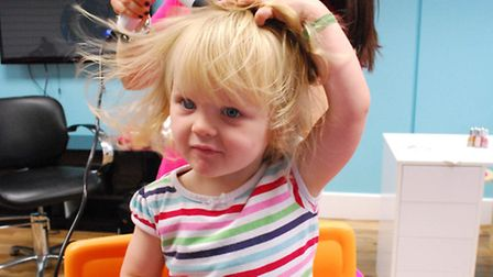 Eilis Geehan, 2, and stylist Aliana get to grips with her first hair cut plus salon owner Susan M