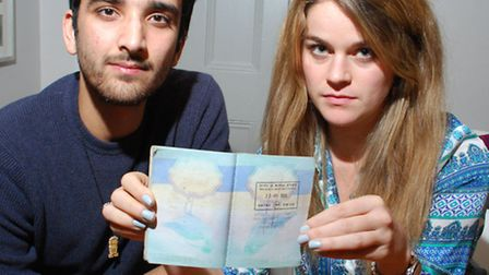 "Harres Yakubi and Rachel Horigan, displaying her passport with an ""Entry Denied"" stamp from Israeli"