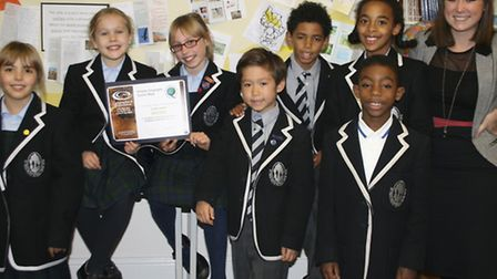 Head of Geography Rebecca Emberey and pupils of Devonshire House Preparatory School