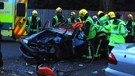 The fire brigade had to cut the roof off a BMW to rescue a woman after a car crash in Hampstead Lane