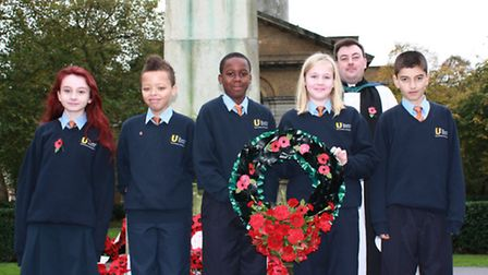 The Urswick School pupils lay a wreath at the cenotaph at St-John-at-Hackney church in Lower Clapton