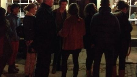Harry Styles surrounded by fans outside La Creperie de Hampstead. Picture: Twitter/@Go1DenUpdates.