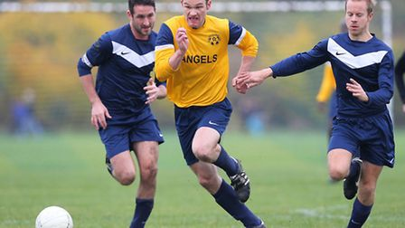 Athletico Angels (in yellow) beat Bocca Albion 8-1 in the Jack Morgan Cup Football at Hackney Marshe
