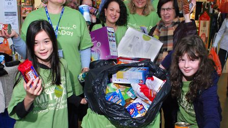 Volunteers from Liberal Jewish Synagogue collect donations from shoppers at Sainsbury's at the O2 Fi
