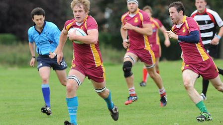 Jordan Wood (centre) in action for Hampstead. Pic: Paolo Minoli