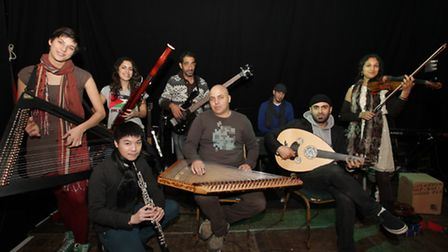 A group of Arab music students from Palestine and Israel play at Chats Palace during a music exchang