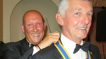 Pictured is outgoing President of the Rotary Club of Lowestoft East Point, Paul Wilkinson ( left) pr