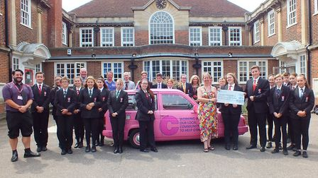 Pledge cheque presentation at the charity week at Ormiston Denes Academy in aid of Cancer Research U