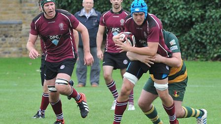 Tom McKelvey (centre) in action for UCS Old Boys. Pic: Nick Cook/UCS Old Boys RFC