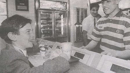 Ben Williamson, aged seven, buying the first meal at the opening of the new McDonald's in Hampstead