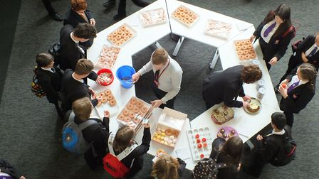 Cake sale as part of the charity week at Ormiston Denes Academy in aid of Cancer Research UK. Photo: