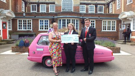 Ormisoton Academy's Head Boy & Head Girl with Suzanne Chapman presenting the plegde cheque at the ch