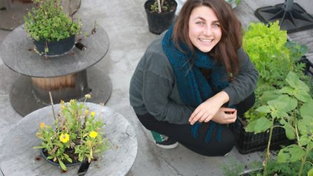 Nathalie Mady in the rooftop garden she made