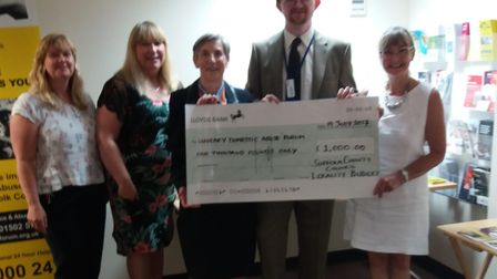 Suffolk County councillor Jamie Starling presents locality budget funding to the Waveney Domestic Vi