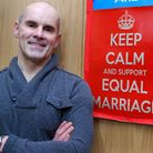 Father Andrew Cain has put up 'Keep calm and support equal marriage' posters after condemning the An