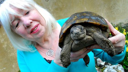 Carey Miller with Adolf the tortoise, who finally come out of hibernation in April. Picture: Polly H