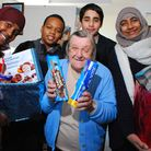Students from Haverstock School deliver Christmas Hampers to pensioners on the Denton Estate. Pictur