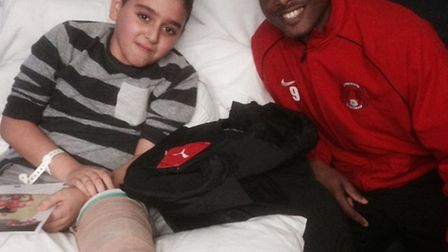 Leyton Orient forward Kevin Lisbie with 12-year old Umut Bozdere at Homerton Hospital