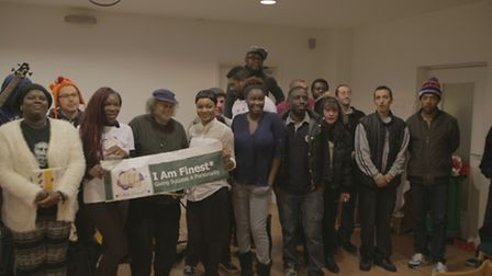 Nana Adjei (fourth from right) with people from St Mungo's Homeless shelter