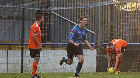 Wingate striker Adam Bolle celebrates his debut goal against Hendon. Pic: Andrew Rowland