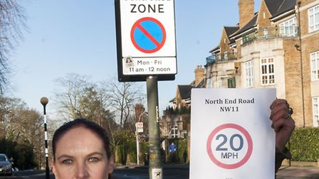 Katherine Travers in front of the new 30mph speed limit sign on North End Road. Picture: Nigel Sutto