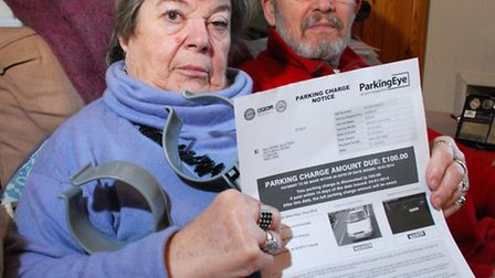 Irene and John Slatter with a parking fine they received at the Royal Free Hospital. Picture: Polly