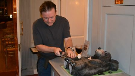 Ricky Gervais trimming the toenails of the bear cake. Picture: Nicky Vyvyan-Robinson