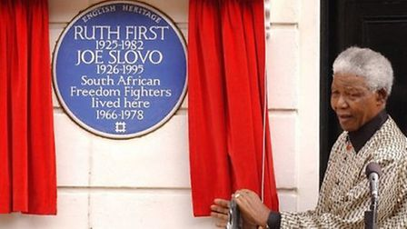 Nelson Mandela unveils a plaque at the former home of anti-apartheid campaigners Ruth First and Joe