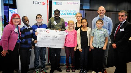 The group shot is of a number of learners and staff collecting the prize of �5,000 for the Internati