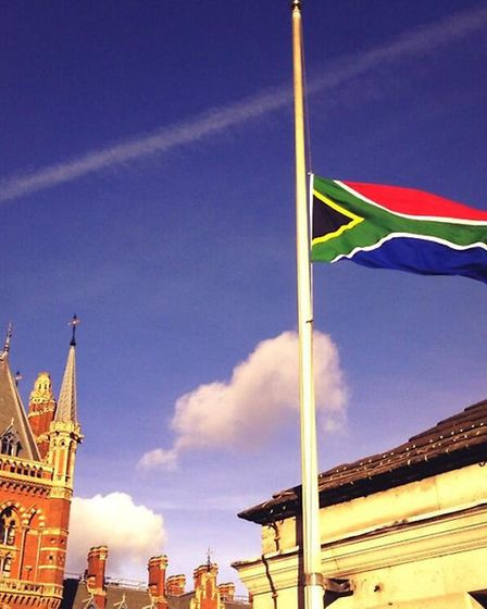 The South African flag flies at half-mast above Camden Town Hall