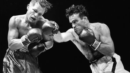 Marcel Cerdan of France delivers a hard right to American boxer Tony Zale's face during their World