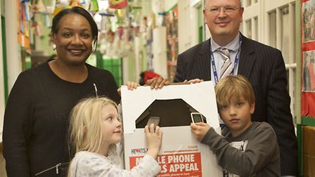 MP Diane Abbott, Grasmere head teacher Mark Derrington and youngsters from the school - Evie Smith (