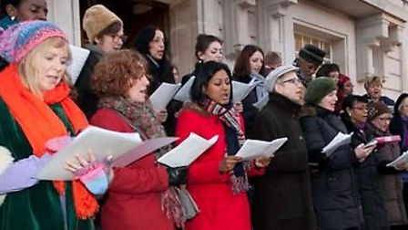 Hackney Empire Community Choir sing Christmas carols during lights switch-on. Picture: GARY MANHINE