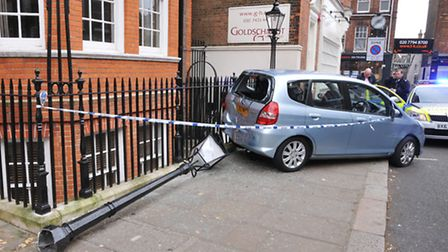 A car mounted the pavement and knocked down a lamppost in Church Row, Hampstead. Picture: Photocraft