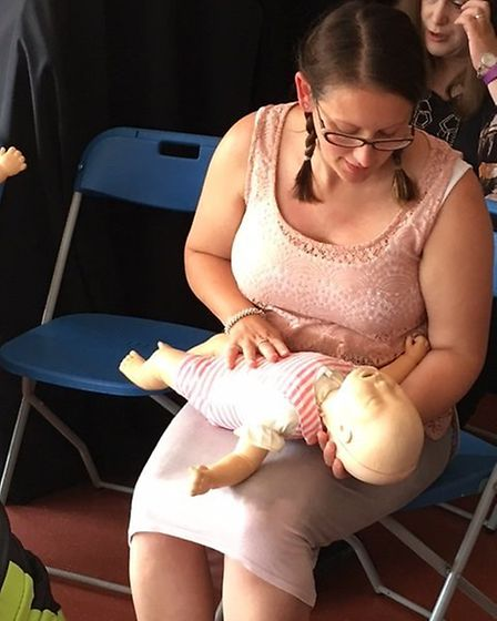 Lee-Ann Philpott, a mum from Oulton, practices baby life saving techniques on a simulator.Pictures: