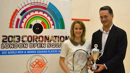 Emily Whitlock receives the women's trophy from Anthony Todd, the CEO of Aspect Capital