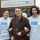 Robert Powell opens the Winter Fair at Marie Curie Hospice in Hampstead with Natasha Evans and Alyso