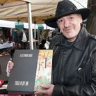Music writer Charles Shaar Murray selling his books, CDs and records at West Hampstead Market. Pict