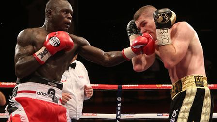 Liam Smith and Erick Ochieng (left) in action during the vacant BBBofC British Light Middleweight Ti