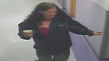A CCTV image of a woman who called herself Jean Noland leaving Homerton Hospital
