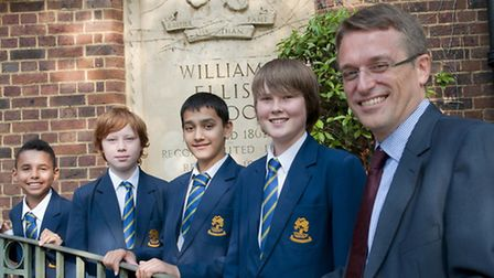 William Ellis School headteacher Sam White, pictured with pupils when he joined the school three yea