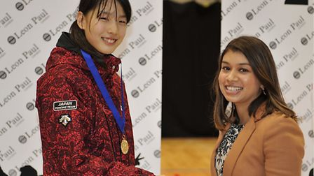 Camden councillor Tulip Siddiq (right) presents the gold medal to winner of the women's individual e