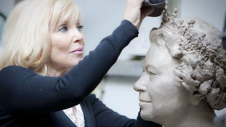 Frances Segelman with her bust of the queen