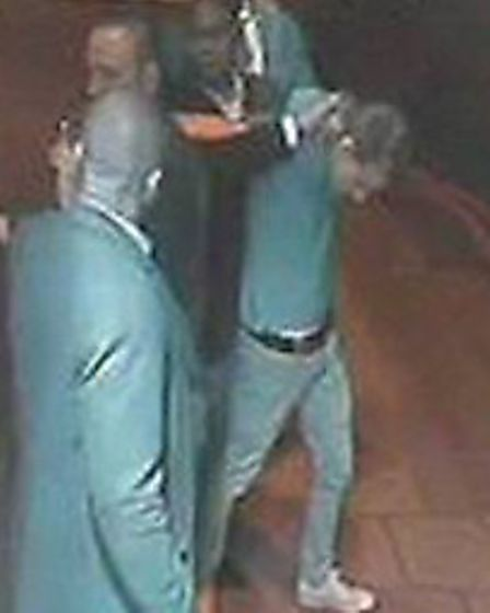 Officers are hoping to trace the man being held by bouncers outside Caipirinha in Archway Road
