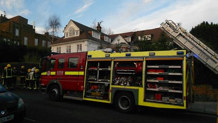 Firefighters tackle the blaze in Kidderpore Avenue, Hampstead, this afternoon