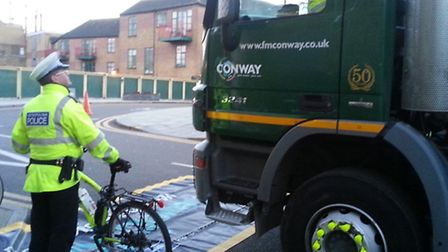 Hackney Police teach cyclists how to cycle safely next to lorries in London Fields last week