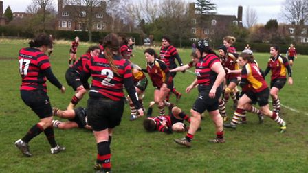 Hampstead Ladies (in red and gold) in action against Blackheath on Sunday